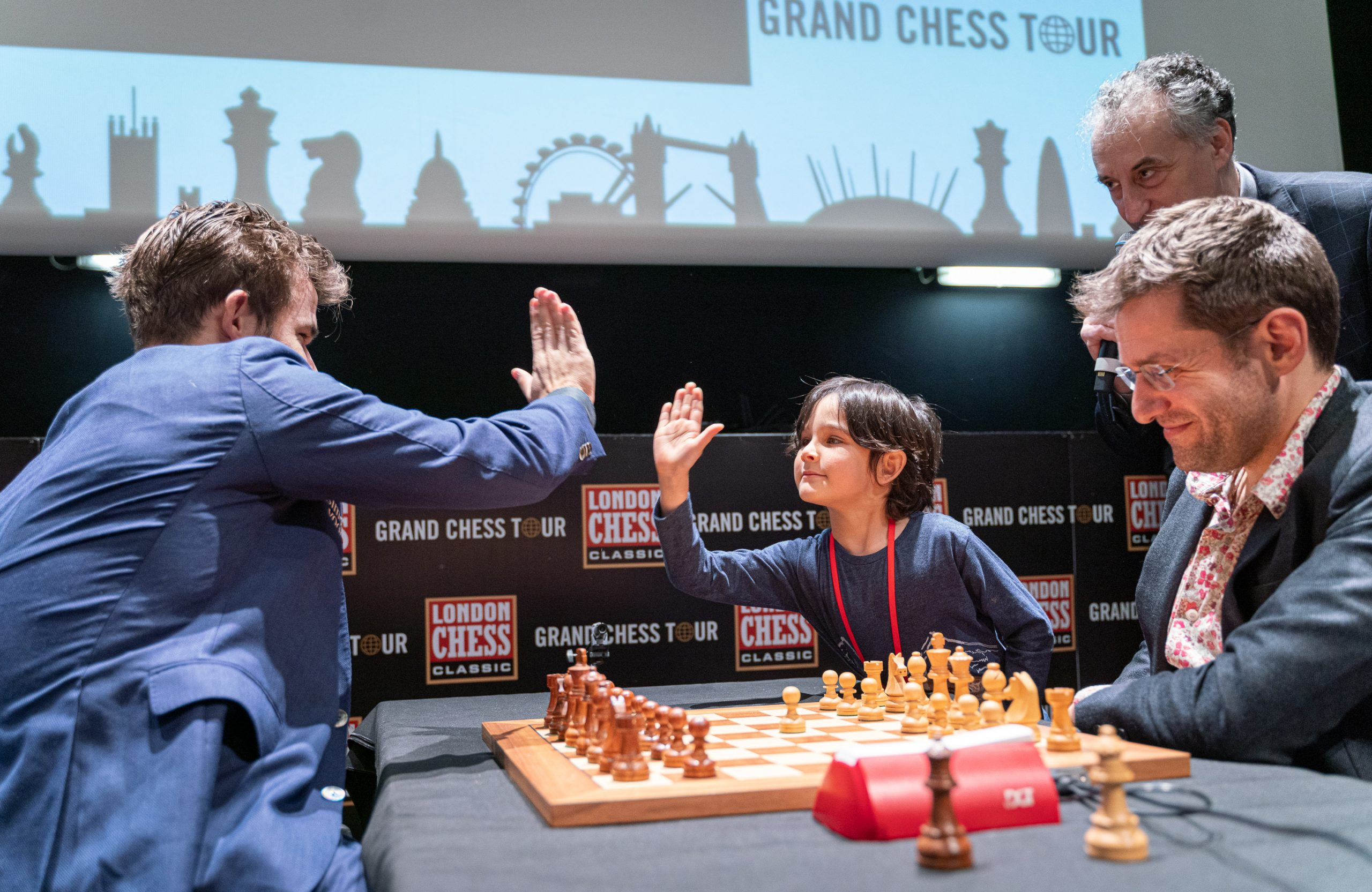 High five! Young stars meeting older ones | Image courtesy of Grand Chess Tour